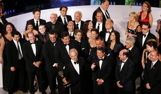 "** FILE ** In this 2007 file photo, ""Sopranos"" producer David Chase, holding the award for best drama series, was surrounded by the cast and crew of the mob drama at the 59th Primetime Emmy Awards in Los Angeles. (Associated Press)"