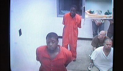 Venjah K. Hunte (above, front), 20, and Charles Wardlow (above, rear), 18, appeared in prison outfits via closed-circuit TV yesterday at the Lee County Justice Center in Fort Myers, Fla. Mr. Hunte, Mr. Wardlow and two others, including Eric Rivera Jr. (right), 17, were arrested in December 2007 in connection with the shooting death of Washington Redskins star Sean Taylor.