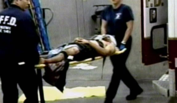 ** FILE ** In this Oct. 7, 2007, this image taken from KGO television shows paramedics transporting a victim of a tiger mauling to San Francisco General Hospital on Tuesday. The man and another victim were in stable condition.