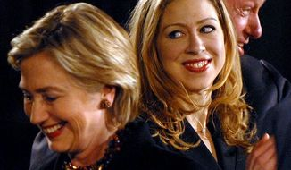 Democratic presidential hopeful Sen. Hillary Rodham Clinton, D-N.Y.,left, accompanied by daughter Chelsea and husband former president Bill Clinton attends a New Year's Eve rally, Monday, Dec. 31, 2007, in Des , Monday, December 31, 2007. (Astrid Riecken/The Washington Times)