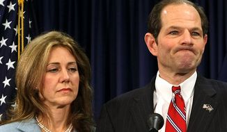 Agence France-Presse/Getty Images STEAMROLLED: New York Gov. Eliot Spitzer was joined by wife Silda at a press conference yesterday. He apologized to his family and the public but did not mention the high-priced prostitution ring that he is accused of using.