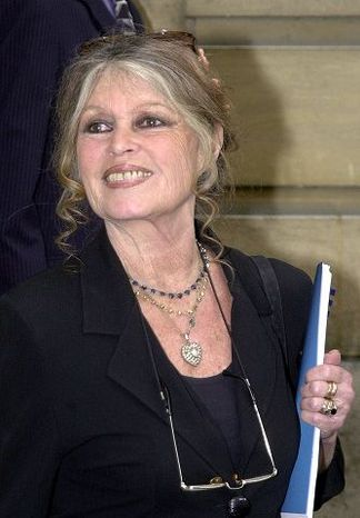 ** FILE ** Former French film star Brigitte Bardot smiles following her meeting with French Prime Minister Lionel Jospin in Paris Monday, July 16, 2001. (AP Photo/Jacques Brin