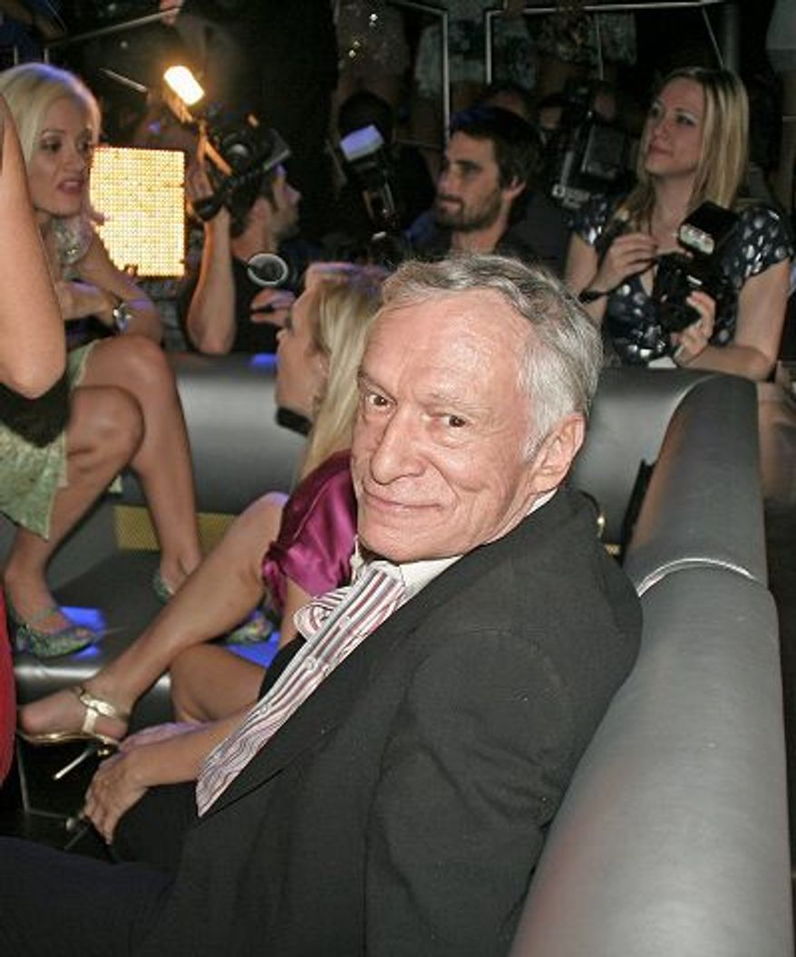 Alison Reynolds/Special to The Washington Times Camera crews, press, well-wishers and beautiful young ladies celebrate Hugh Hefner's 82nd birthday.