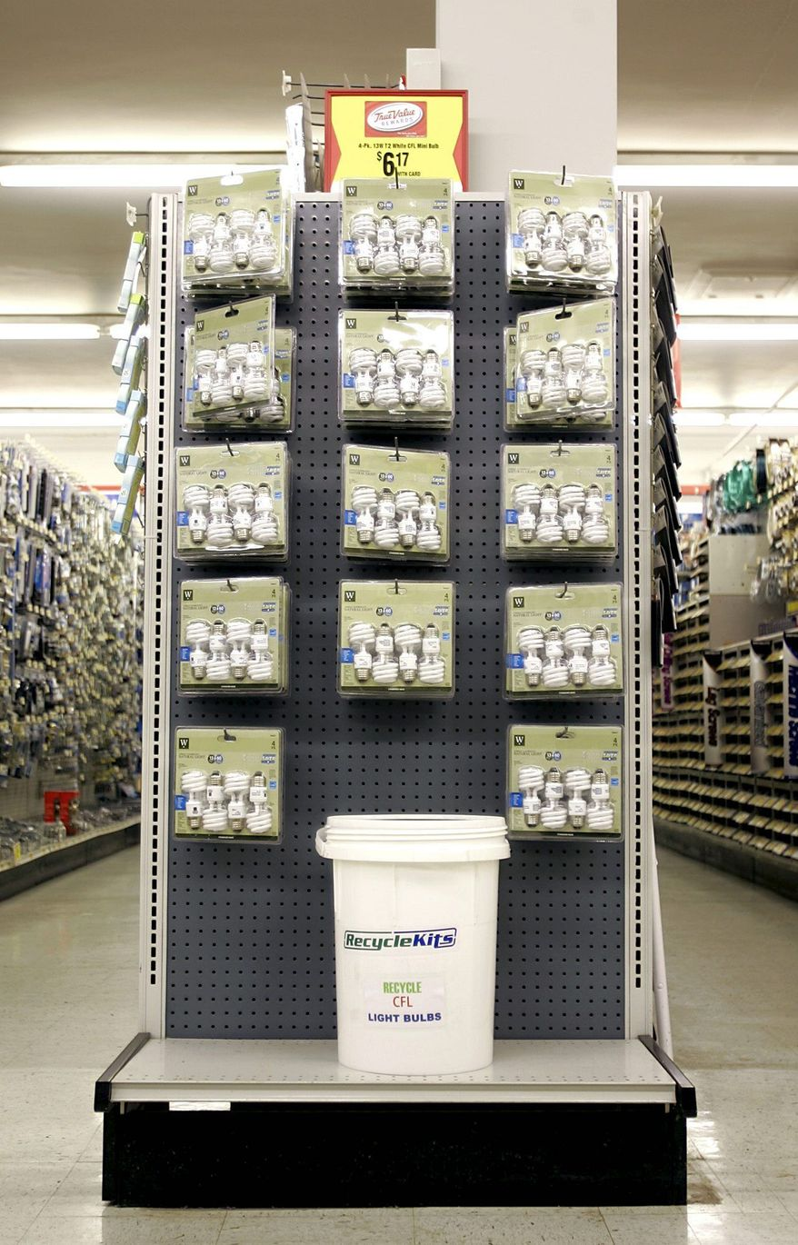 Compact fluorescent light (CFL) bulbs are displayed at Ritters True Value Hardware in Mechanicsburg, Pa. Associated Press