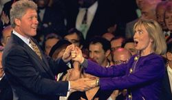 """** FILE ** Seen here two days before the 1992 presidential election, Bill Clinton and Hillary Rodham Clinton dance on stage at a rally at the Brendan Byrne Arena in East Rutherford, N.J. Fleetwood Mac's """"Don't Stop"""" was that year's campaign theme song. (Associated Press)"""