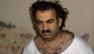 **FILE** Khalid Sheikh Mohammed is seen shortly after his capture during a raid in Pakistan in this photo from March 1, 2003. (Associated Press)