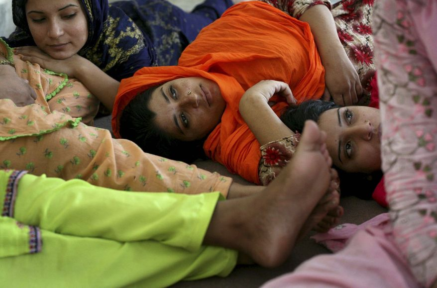 ** FILE ** The battered women at the shelter rely on one another for companionship, having been rejected by their families. A common punishment in Pakistan, should they return home, is being burned with acid. An official at Human Rights Watch stressed that more burn units are critical.