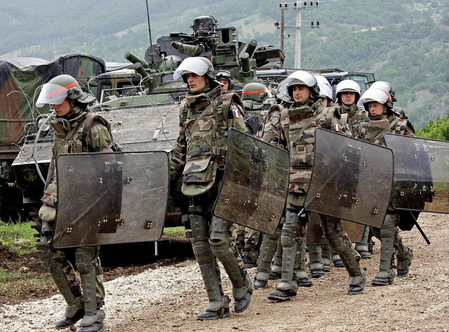 ** FILE ** NATO-led French troops move to take up positions during exercises at the border between Kosovo and Serbia in 2008. (Associated Press)