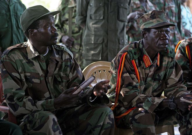 **FILE** Lord's Resistance Army (LRA) leader Joseph Kony (left) and a deputy, Vincent Otti, meet with a U.N. official in Ri-Kwangba, Sudan, in 2006.