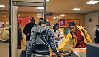 Students passing through metal detectors is a common ritual in inner-city schools. (Barbara L. Salisbury/The Washington Times)
