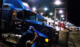 Truckers line the pumps at the Flying-J north of Winchester, Va. (The Washington Times) **FILE**