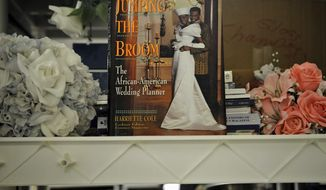 **FILE** Silk flowers and wedding-planning guides are among the items available at St. Anthony's Bridal in Bethesda, a one-stop lending shop for engaged couples. (The Washington Times)