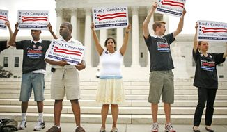 Photographs by Katie Falkenberg/The Washington Times Gun-control activists in front of the Supreme Court show their support for the gun ban and the Brady Campaign to Prevent Gun Violence.
