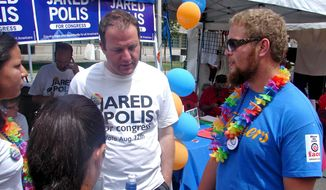 The next three show a man, Jared Polis, talking to three people. Caption: Colorado Democrat Jared Polis, who's running for Congress, discusses the issues with Pridefest-goers Alex Hernandez, Kelsey Ray and Kyle Pape.  Valerie Richardson/ Special to The Washington Times
