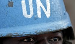 ** FILE ** A United Nations soldier in Darfur (UNAMID) stands guard at a checkpoint on the outskirts of Darfur.
