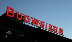** FILE ** In this April 21, 2008 file photo, a Budweiser sign is seen atop one of the buildings at the Anheuser-Busch brewery in St. Louis. Belgian brewer InBev announced Monday. July 14, 2008, it will buy Anheuser-Busch for $52 billion. (AP Photo/Jeff Roberson, file)
