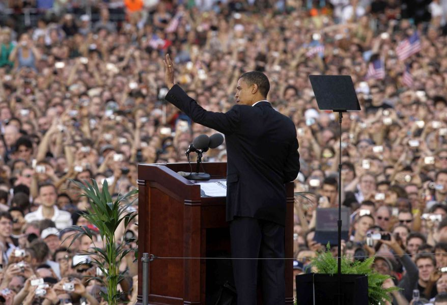 Barack Obama waves to the crowd as he delivers a speech at the victory column in Berlin Thursday, July 24, 2008, during a visit to Germany in the middle of his campaign to become U.S. president.