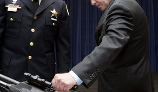 ASSOCIATED PRESS Chicago Mayor Richard Daley, a supporter of gun control, and Chicago Police Assistant Deputy Superintendent Matt Tobias examine assault weapons in 2006.