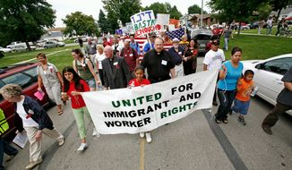 ASSOCIATED PRESS Protesters march during a rally after a federal immigration raid of the Agriprocessors plant in Postville, Iowa, in May. The Rubashkin family, which runs the kosher slaughterhouse, deny accusations they knowingly hired illegal immigrants.
