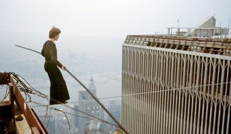 Frenchman Philippe Petit walks a high wire between the Twin Towers of the World Trade Center on Aug. 7, 1974. He performed the feat eight times in one hour. (Copyright 2008 Jean-Louis Blondeau/Polaris Images)