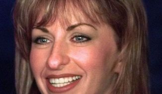 Paula Jones smiles during a news conference in Dallas, in this April 16, 1998, file photo. Encouraged by an outside lawyer, Paula Jones is ready to insist on $2 million, half from President Clinton and half from a New York tycoon, in exchange for dropping her sexual harassment lawsuit, two legal sources involved in the case said Saturday, Oct. 17, 1998. (AP Photo/LM Otero) ** FILE **