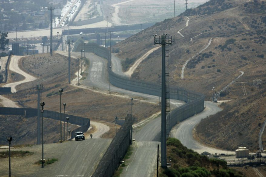 A U.S. Border Patrol vehicle patrols between the primary and secondary fences along the U.S.-Mexico border south of San Diego, a sector some critics contend is being too generously staffed at the expense of Arizona and Texas. (Associated Press)