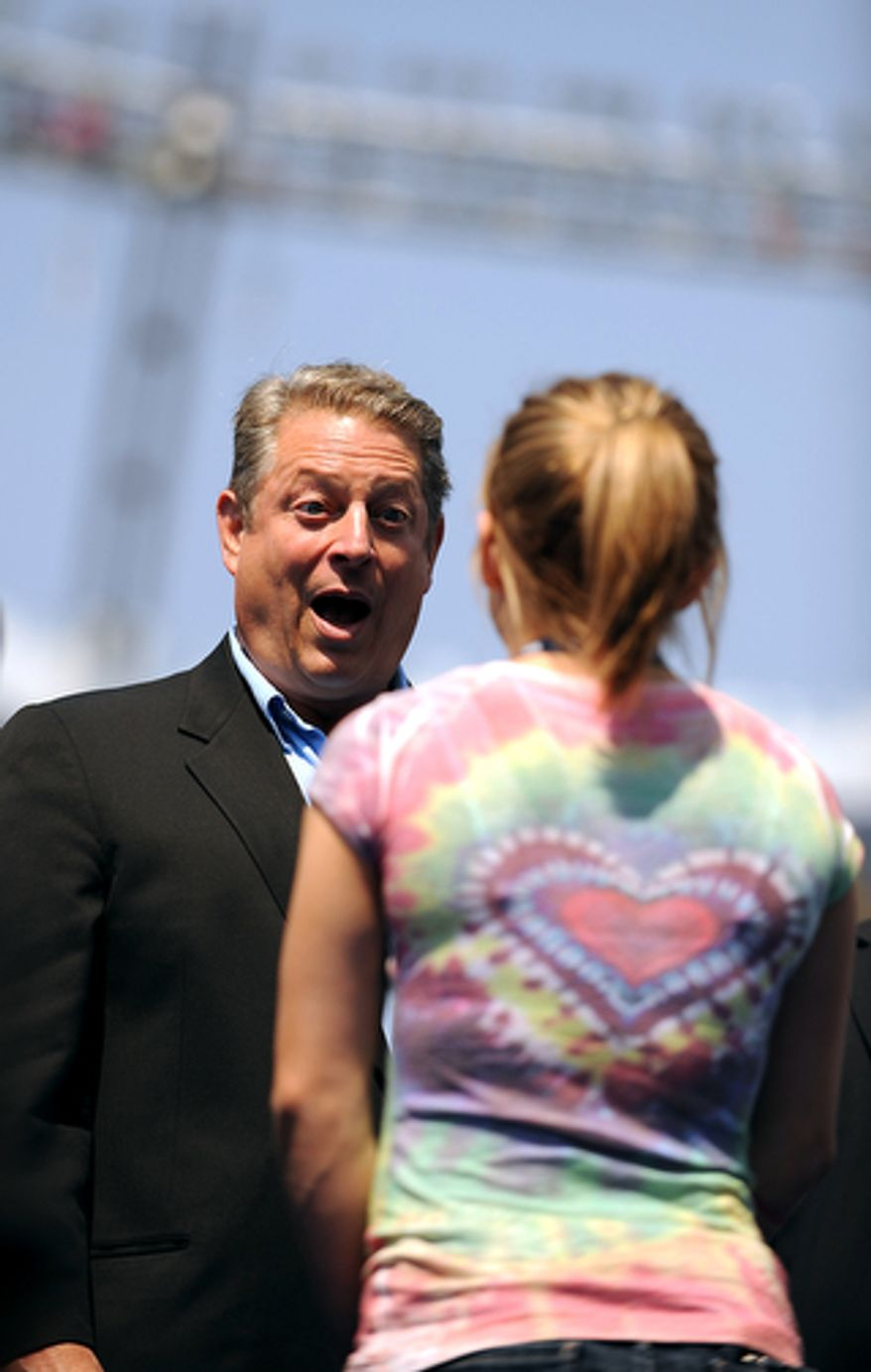 Former Vice President Al Gore meets Olympic gold-medalist Shawn Johnson at Invesco Field. (Allison Shelley/The Washington Times)
