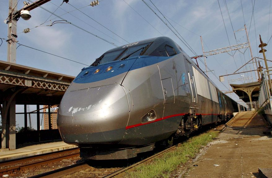 An Amtrak Acela train, with its distinctive bullet nose, pulls into the Wilmington, Del., station after making a fast run from Washington, D.C. (Bloomberg News)