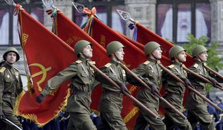 GETTY IMAGES Russian soldiers march in the annual Victory Day parade in Moscow in May. The resurgent military's deployment to Georgia gives Russia a credible threat of force.
