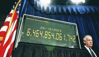 Sen. Paul Sarbanes (D-MD) stands next to the national debt clock used as a prop during a press conference at the Capitol in Washington D.C., USA, Tuesday afternoon May 13, 2003. ( Rod A. Lamkey Jr. / The Washington Times )