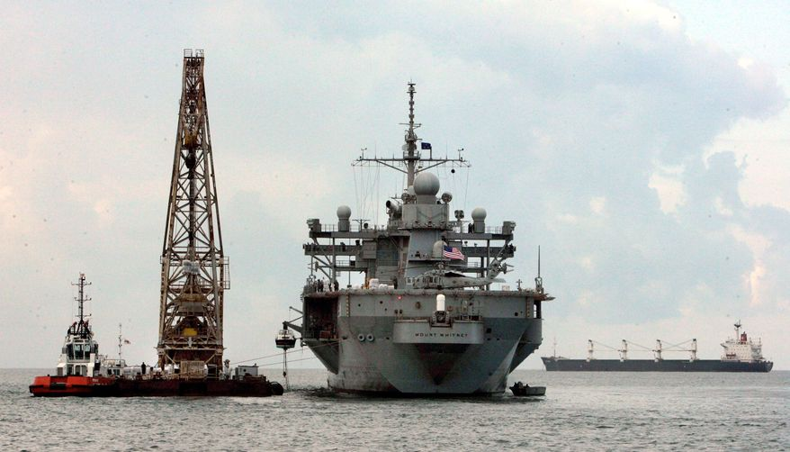 DELIVERY: The USS Mount Whitney unloads aid in Poti, Georgia, on Saturday. Russian forces that invaded Georgia seized more than just U.S. Humvees. (Associated Press)