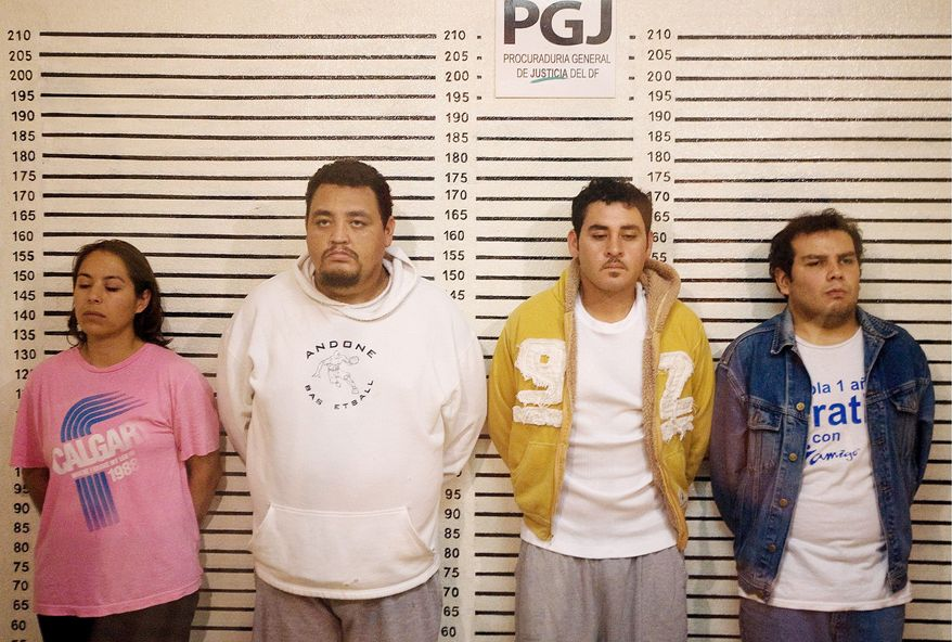 """AGENCE FRANCE-PRESSE/GETTY IMAGES Members of the """"Flower Gang"""" were detained in Mexico City as suspects in the slaying of a 14-year-old boy whose body was found in a car trunk Aug. 1. The death of the son of a business tycoon set off anti-crime demonstrations across Mexico."""