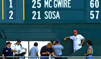 Agence France-Presse / Getty Images Mark McGwire and Sammy Sosa fascinated baseball fans with their pursuit of Roger Maris' record in 1998.