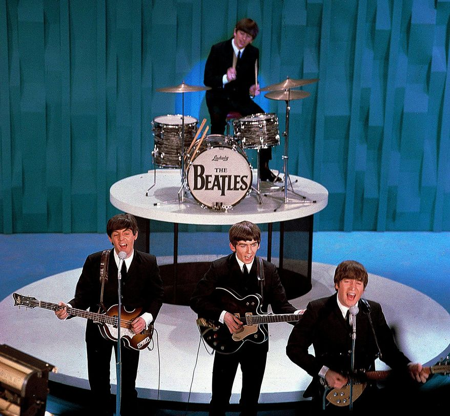 """The Beatles perform on """"The Ed Sullivan Show"""" in 1964. Ringo Starr is on drums, and in front are (from left) Paul McCartney, George Harrison and John Lennon. (Associated Press)"""