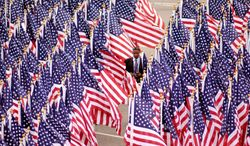 ** FILE ** Flags commemorate each of the victims killed at the Pentagon on Sept. 11, 2001. (Astrid Riecken/The Washington Times)