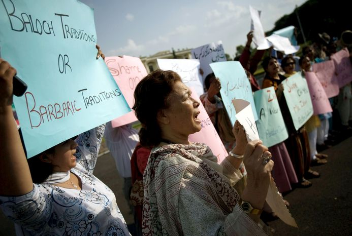 """** FILE ** Pakistani human rights activists demonstrate outside Parliament in Islamabad in 2008. The brutality of recent """"honor killings"""" and the police response sparked outrage in Pakistan. (Associated Press)"""