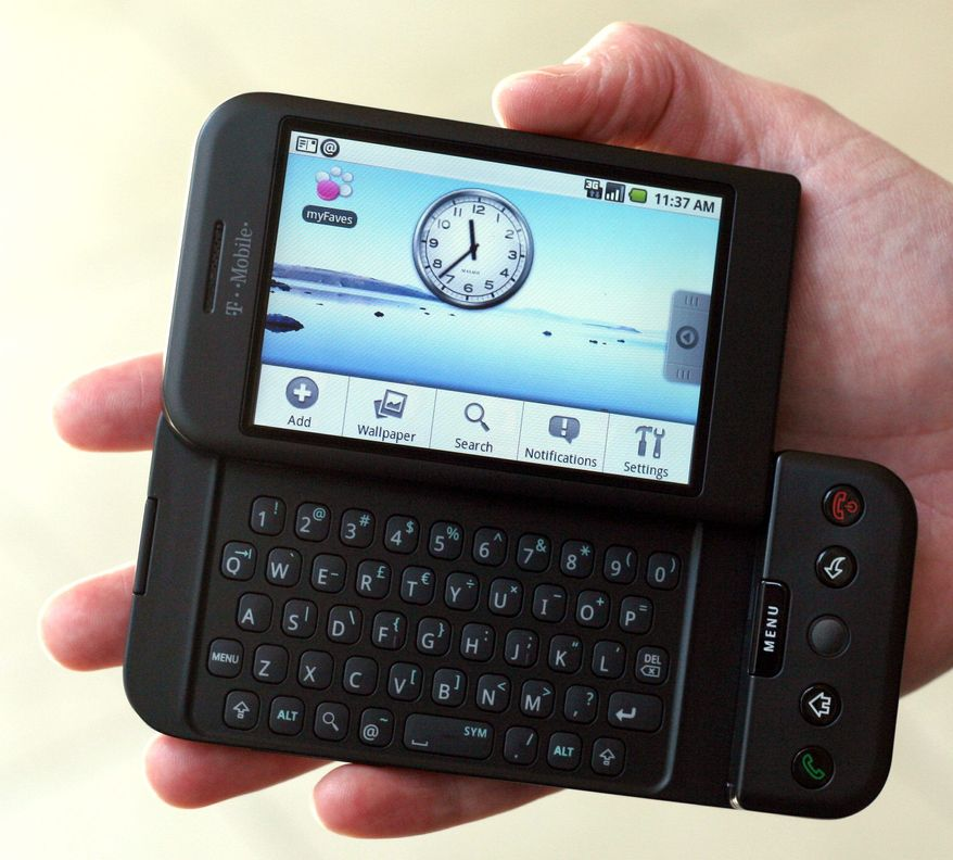 ** FILE ** This Sept. 23, 2008, file photo shows the T-Mobile G1 Android-powered phone, the first cell phone with the operating system designed by Google Inc., during its debut in New York. It costs $179 with a two-year contract. (Associated Press)