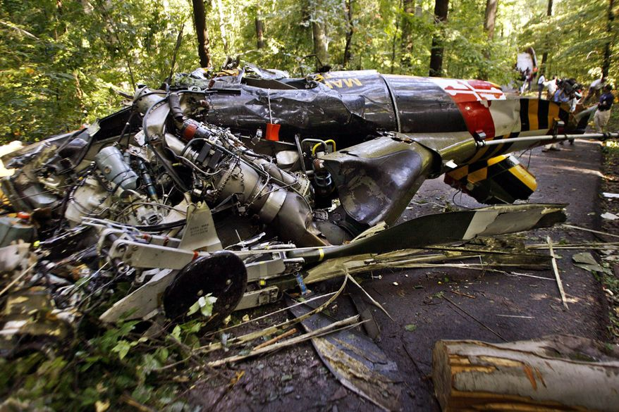 Wreckage from the Maryland State Police medevac helicopter crash that killed four people is scattered on one side in Walter Mill Regional Park in District Heights in September 2008.