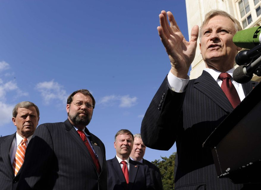 **FILE** House Financial Services Committee ranking Rep. Spencer Bachus (right), Alabama Republican, speaks Oct. 2, 2008, during a news conference on the financial market turmoil on Capitol Hill. (Associated Press)