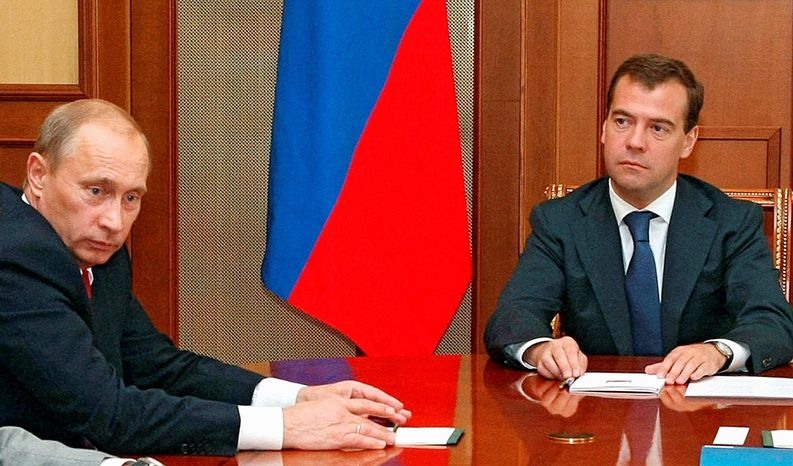 AGENCE FRANCE-PRESSE/GETTY IMAGES Russian President Dmitry Medvedev (above right) meets with Prime Minister Vladimir Putin and the Security Council (unseen) in Sochi on Aug. 26. At right: Missiles and tanks are on display during a weapons fair in Moscow on Aug. 20. During his two terms as