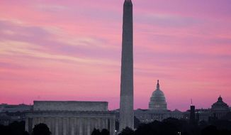 ASSOCIATED PRESS PHOTOGRAPHS The District's low skyline, contrary to popular belief, has nothing to do with preserving the prominence of the 555-foot Washington Monument. Concerns over increasingly scarce land have spawned debate about allowing taller office buildings.