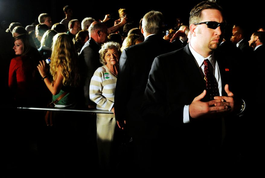 A U.S. Secret Service officer watches the crowd who wait to shake Sen. Biden's hand after the rally. (Mary F. Calvert/The Washington Times)