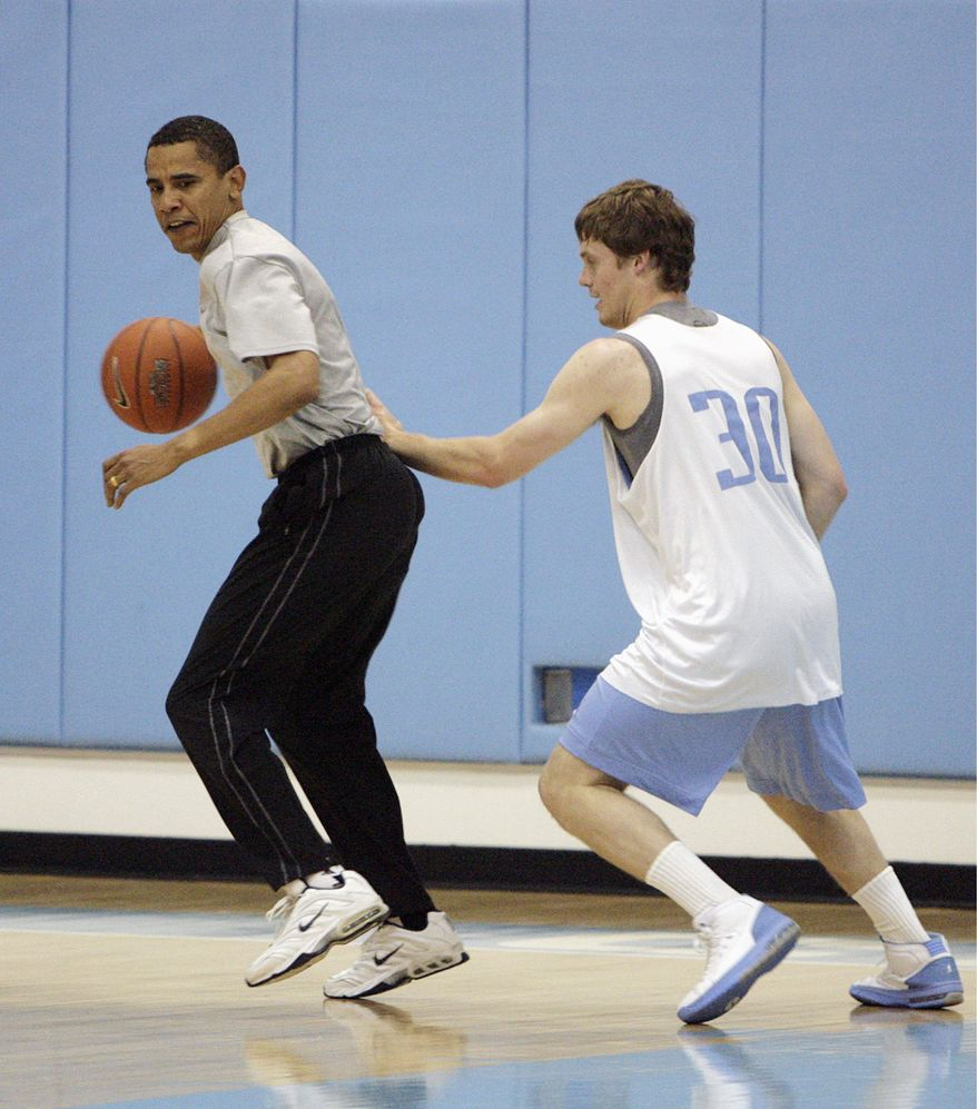 ** FILE ** Then-Democratic presidential nominee Sen. Barack Obama plays basketball with the University of North Carolina's Jack Wooten in Chapel Hill, N.C., on April 29. (Associated Press)