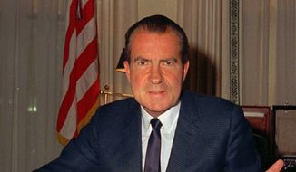 **FILE** President Richard M. Nixon is shown at his desk in the White House on Feb. 16, 1969. On Aug. 9, 1974, Nixon would go down in history as the only U.S. president to resign. (Associated Press)