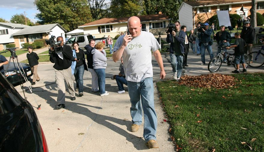 "Joe Wurzelbacher walks to his truck with news media in tow Oct. 16 in Holland, Ohio. Better known as ""Joe the Plumber,"" he remains in the news as the presidential campaign nears its final full week. Republicans now want to know whether personal data about him was illegally obtained. (Associated Press)"