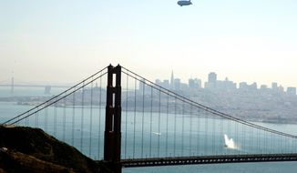 The German-built zeppelin flies over the Golden Gate Bridge, arriving in San Francisco on Oct. 25 to begin aerial tours of the Bay Area. The airship is the first of its kind to fly in the United States in more than 70 years. (Associated Press)