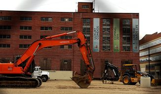 **FILE** Luxury condominiums construction near Nationals Park. (Barbara L. Salisbury/The Washington Times)