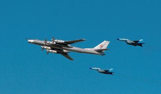 A Russian Tu-95 bomber, surrounded by MiG-29s, participates in an air show marking 95th anniversary of the Russian air forces in August 2007. Coupled with newer long-range missiles, the slower but larger bombers are set to play a role in a modern military. (Agence France-Presse/Getty Images)