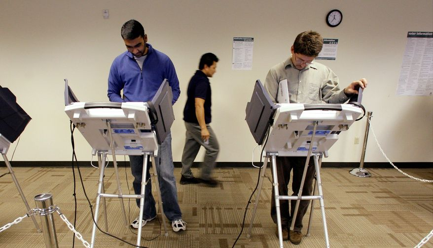 Venkat Murthy (left) and Mark Wolf vote early at the King County Elections office in Renton, Wash. Many counties in Washington state have mail-in-only voting, which can delay results.