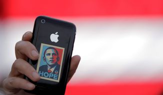 A supporter displays an iPhone during a rally for Sen. Barack Obama in Raleigh, N.C., on Wednesday. Sen. Joseph R. Biden Jr.'s very selection as running mate was officially announced to the world through a telephone text message. ASSOCIATED PRESS